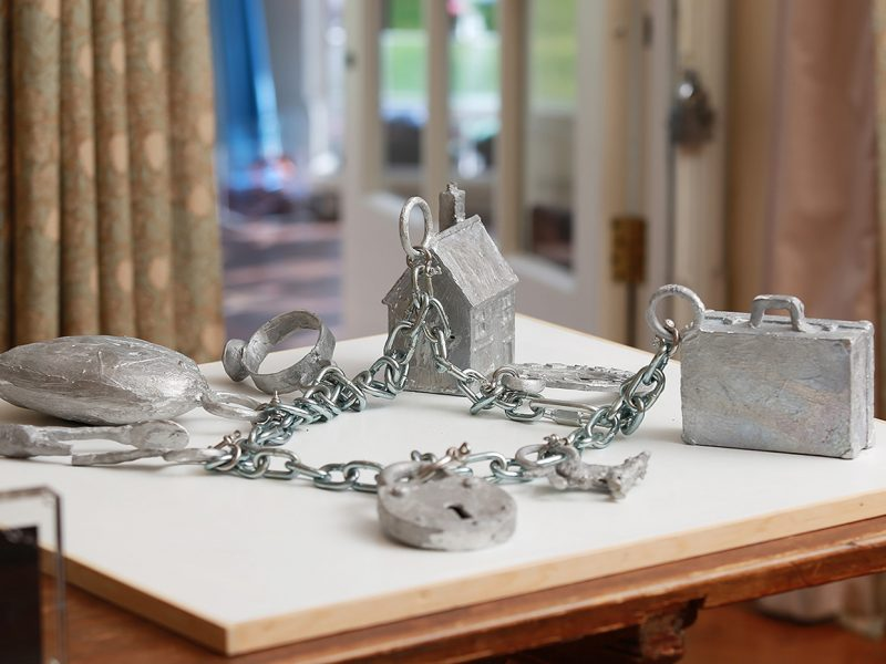 Charms made by artist Paul Coldwell - a suitcase, a padlock and a house are