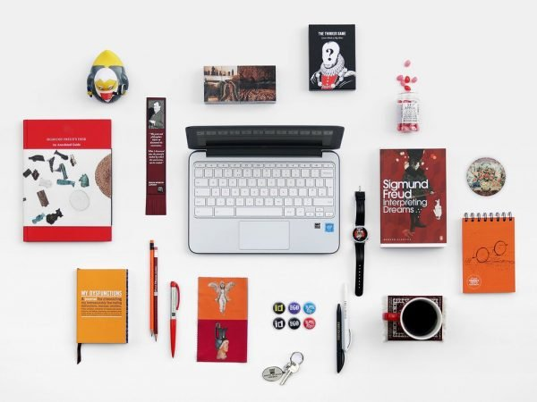 A selection of items from the Freud Museum shop, including books, stationery, badges, mugs and a wristwatch.