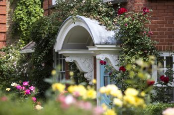 photograph of front door at Freud Museum surrounded by roses