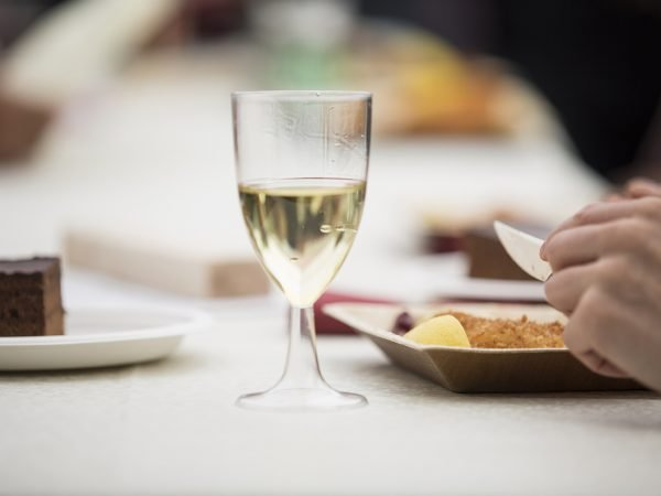 photographing detailing someone eating a meal. central to the image is a wine glass