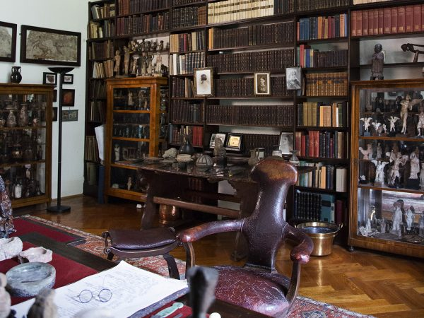 Photographs of shelves and desk in Freud's Library