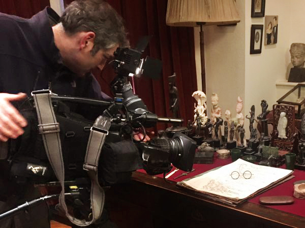 Camera crew filming Freud's desk