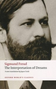 Cover of book which details book title and a black and white photograph of Sigmund Freud - Interpretation of Dreams