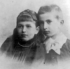 Black and white photograph of a young girl and a boy.