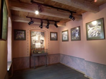 Interior of a room with framed prints on the walls.