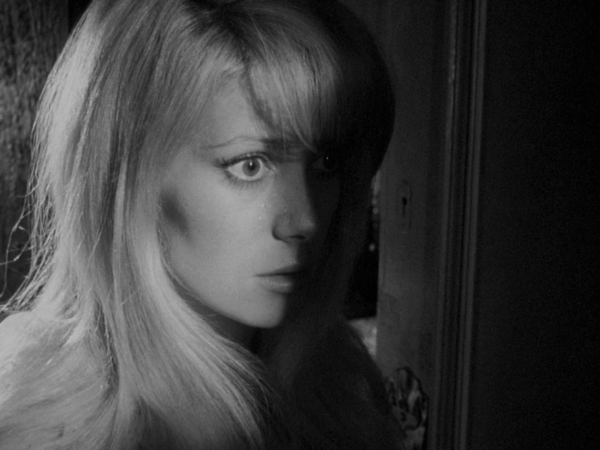 Catherine Deneuve in Repulsion film Roman Polanski, uncanny, woman's face is submerged in shadow
