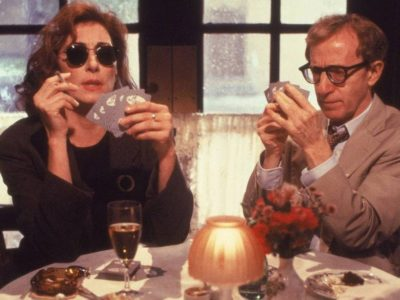 woody allen and angelica houston playing cards